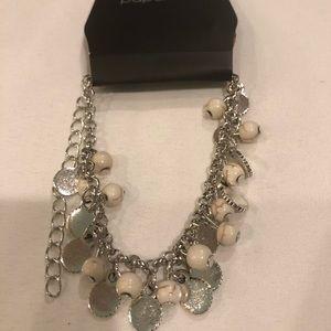 Silver bracelet cream stones